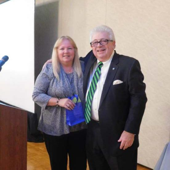Photo Caption: (Medway) President and CEO of Charles River Bank, Jack Hamilton, poses for a picture with Deposit Operations Support Specialist Laurie O'Rourke for her 25 years of service.
