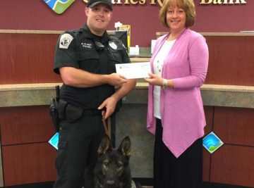 Photo Caption: Nancy Macleod, assistant manager of Charles River Bank Mendon office, presents Officer Pichel and his k-9 partner Brady with a donation check of $500 to support the Mendon K-9 program. The program began in December, 2015, and is intended to assist the police force in more effectively patrolling the town of Mendon.