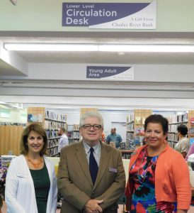 Photo Caption: (Mendon) Ann Gonyea, Assistant Vice President and Mendon Branch Officer, Jack Hamilton, President and CEO, and Ann Sherry, Vice President of Customer Care and Relationship Development, pose for a picture at the newly opened Taft Public Library. The new library's Lower Level Circulation Desk was funded through a $2,500 contribution from Charles River Bank.